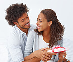 Beautiful African American pleased wife looking at her handsome husband and smiling