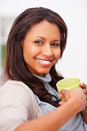 Cute young female holding a cup and smiling