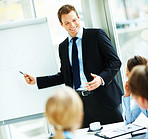 Confident smart attractive businessman giving presentation to his colleagues