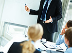 Cropped image of a business man during a presentation with his colleagues