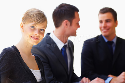 Buy stock photo Portrait of a young executive with colleagues in the background