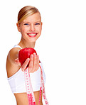 Portrait of happy young female holding red apple and measuring tape