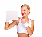 Beautiful young female pointing at blank billboard isolated over white background