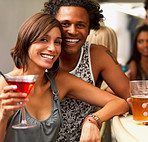 Closeup of a smiling young couple in a bar