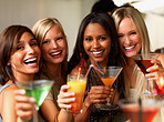 Closeup of a smiling young girls holding drinks