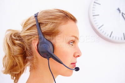 Buy stock photo Closeup profile image of an operator with a wall clock at the background over white background