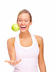 Young woman catching green apple on copyspace