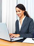 Business woman sitting working on laptop