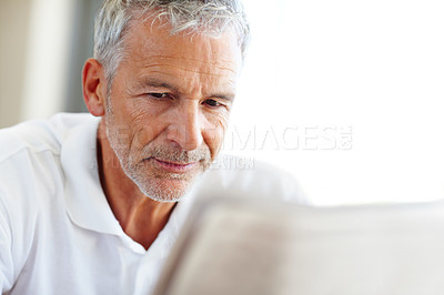 Buy stock photo Senior man reading a newspaper - Copyspace
