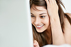 Cute young female enjoying using laptop