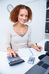 Smiling young woman working in an office