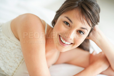 Buy stock photo Charming young woman relaxing on bed