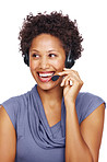 Smiling female executive wearing headset looking away