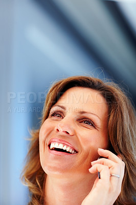 Buy stock photo Cute young woman enjoying conversation on mobile