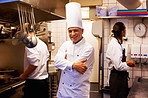 Smiling cook with staff