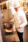 Male chef cooking food