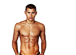 Muscular young guy standing confidently