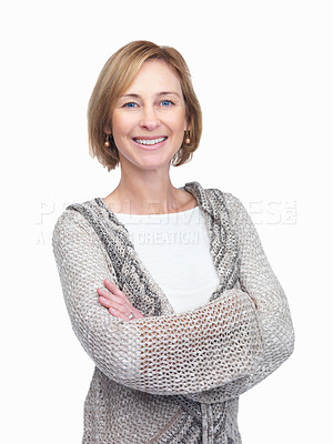 Buy stock photo Happy mature woman smiling at you confidently with her arms folded, isolated on white - copyspace
