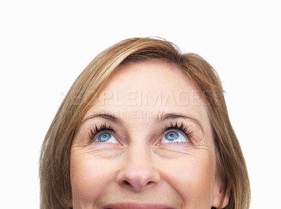 Buy stock photo Cropped image of mature female looking upwards ove