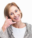 Elegant lady gesturing a call me sign over white background