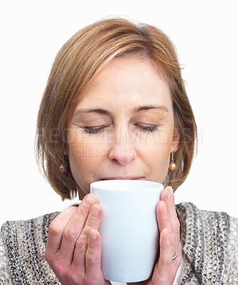 Buy stock photo Attractive mature woman breathes in the aroma of c
