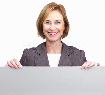 Buy stock photo Happy middle aged woman holding blank board in fro