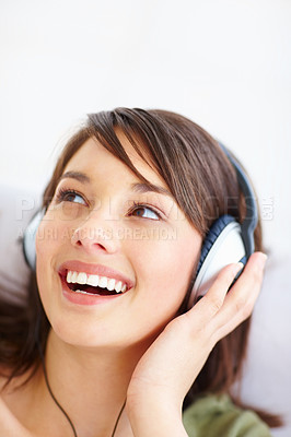 Buy stock photo Modern young woman listening to music