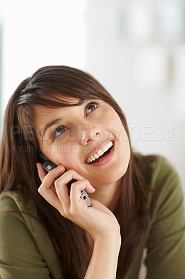 Buy stock photo Beautiful young brunette speaking on a cellphone