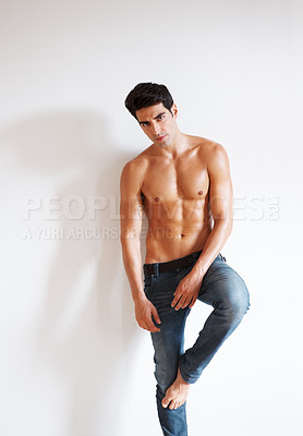Buy stock photo Portrait of muscular young guy standing confidently - Copyspace