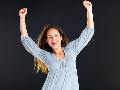 Buy stock photo Happy woman with arms overhead