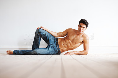 Buy stock photo Portrait of a shirtless young  lying on the floor - Copyspace