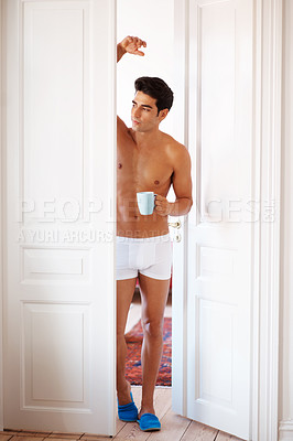 Buy stock photo Portrait of a shirtless young man having a hot cup of coffee at home in morning