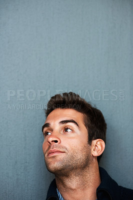 Buy stock photo Studio shot of a handsome young man looking pensive