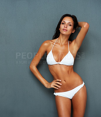 Buy stock photo Sexy woman in a bikini with hand on hip