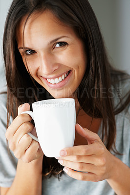 Buy stock photo Pretty woman smiling while holding coffee cup