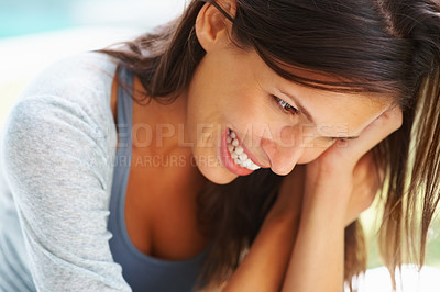 Buy stock photo Pretty woman smiling and looking down
