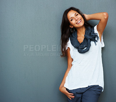 Buy stock photo Woman leaning against blue background with hand in hair