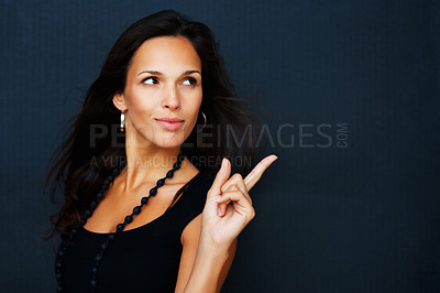Buy stock photo Woman looking and pointing away