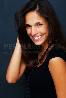 Buy stock photo Woman posing for camera with hand in hair