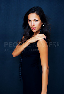 Buy stock photo Woman posing with hand on shoulder