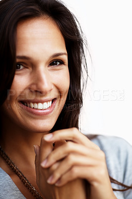 Buy stock photo Closeup portrait of a cute young lady smiling while looking at you
