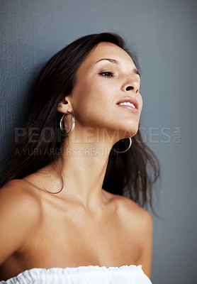 Buy stock photo Portrait of a sexy young woman thinking and looking away