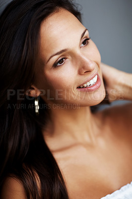 Buy stock photo Closeup portrait of an attractive young lady looking away having a happy thought