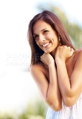 Buy stock photo Portrait of a happy young woman posing in a park - Outdoor