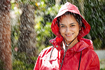 Buy stock photo Portrait of a happy young teenage girl in a red raincoat smiling - Outdoor