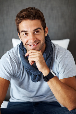 Buy stock photo Portrait of a handsome young man looking happy at home