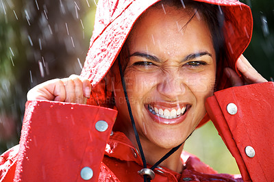 Buy stock photo Closeup portrait of cute young girl wearing a raincoat and enjoying the summer rain - Outdoors