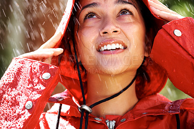 Buy stock photo Closeup of pretty yoiung woman wearing red raincoat looking up - Outdoor