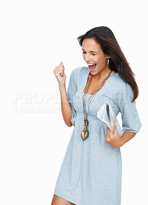 Buy stock photo Woman clutching newspaper and expressing excitement