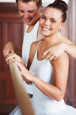 Buy stock photo Portrait of a cheerful young ballet partners having fun after a dance session